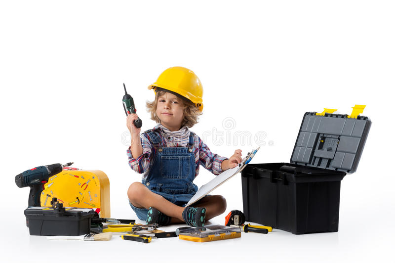 Kleiner Junge gekleidet als Gebrauchsarbeitskraft stockbild