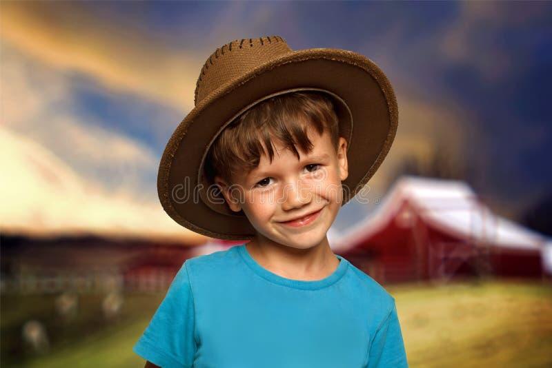 Kleiner Junge im Cowboyhut lizenzfreies stockbild
