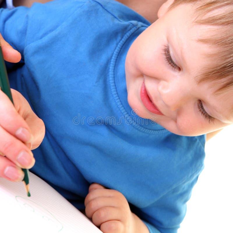 Kleiner Junge möchte zeichnen. stockfoto