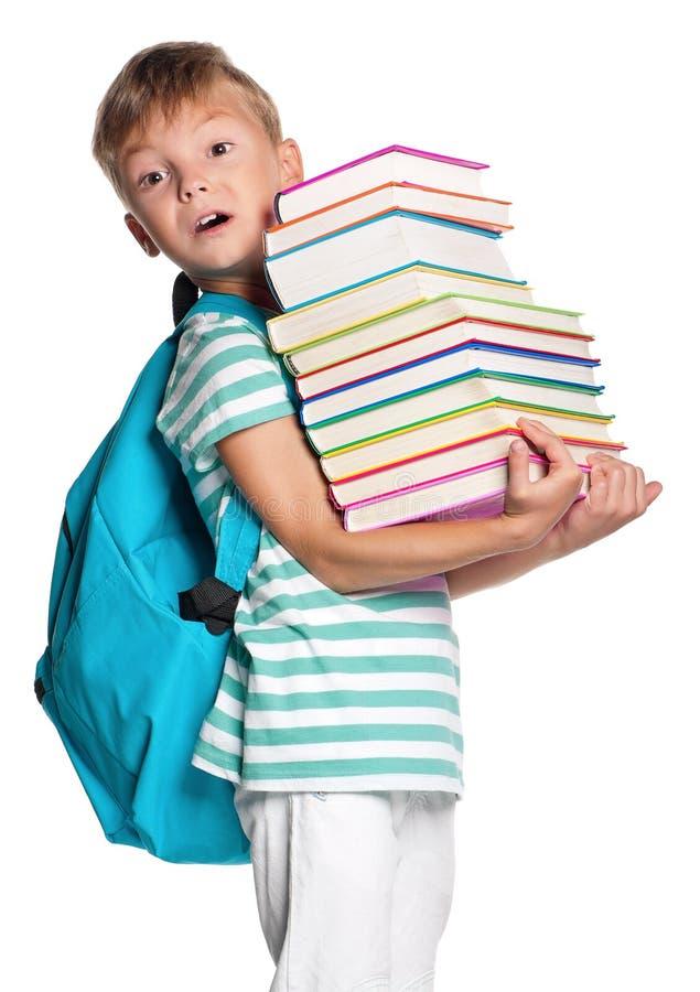 Kleiner Junge mit Büchern lizenzfreies stockbild