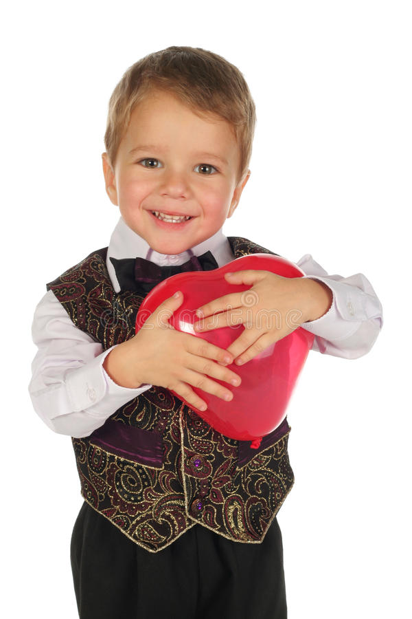 Kleiner Junge mit rotem Ballon lizenzfreie stockfotografie