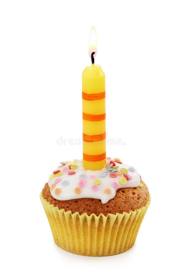 Kleiner Kuchen mit Kerze lizenzfreie stockfotografie