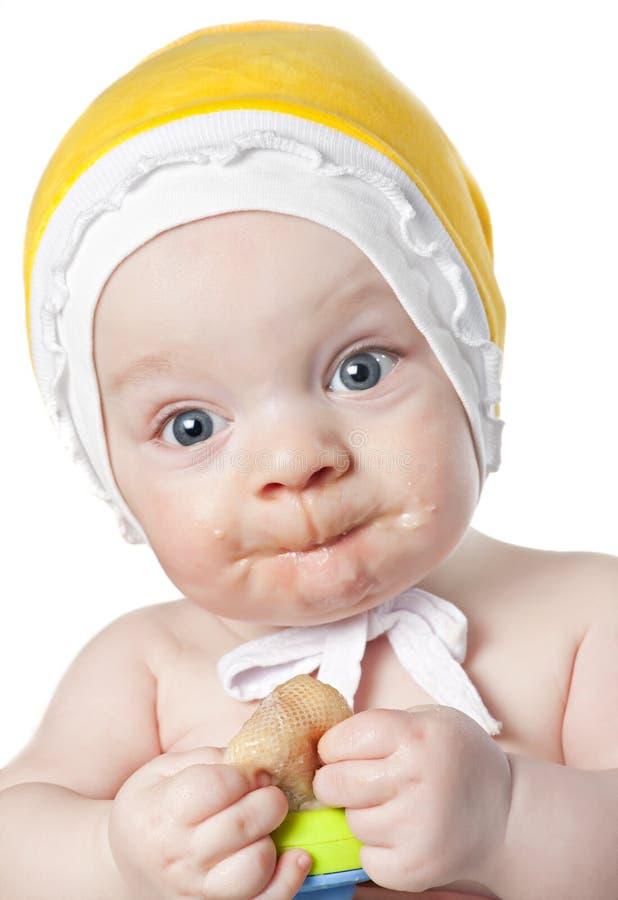 Kleines Baby mit Nibbler lizenzfreie stockfotos