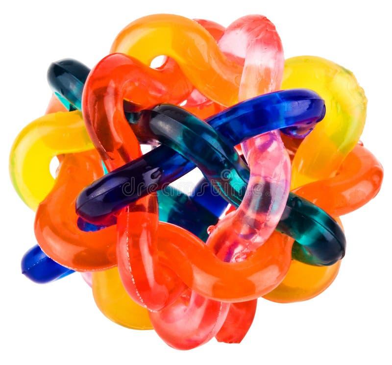 Kleines buntes ineinandergegriffenes flexibles Spielzeug lizenzfreie stockfotografie