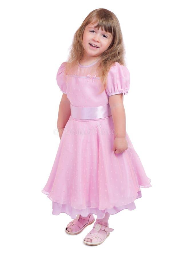 Kleines lächelndes Mädchen im rosafarbenen Kleid stockbild