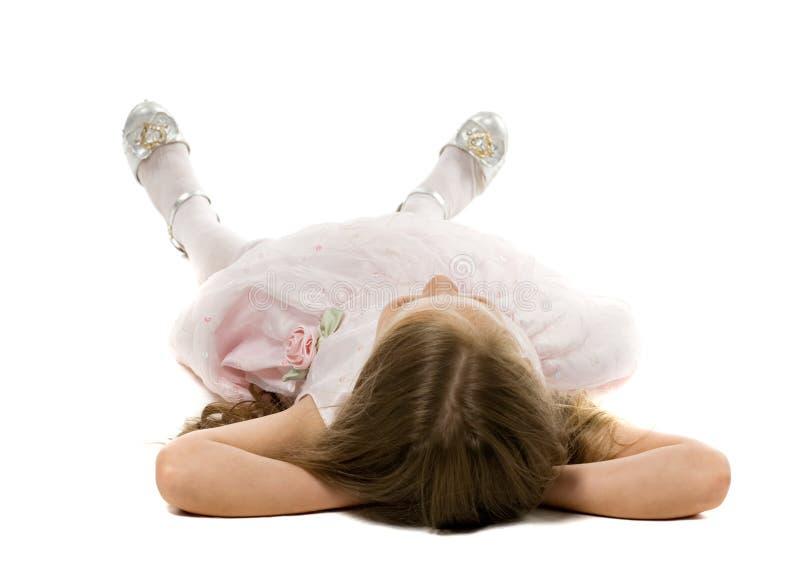 Kleines Mädchen auf einem Fußboden stockfotografie