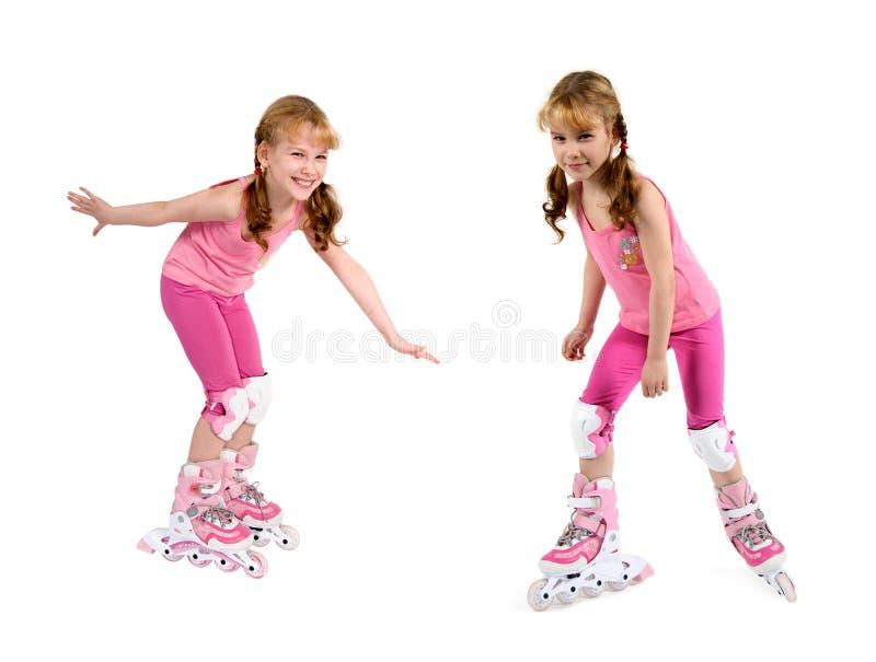 Kleines Mädchen auf Rollen stockfoto