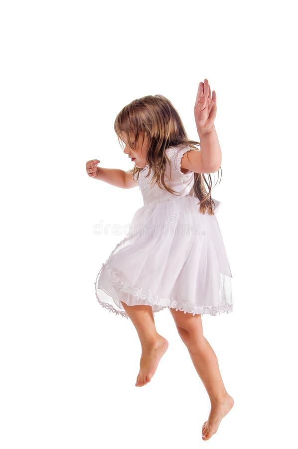 Kleines Mädchen auf Weiß stockfoto