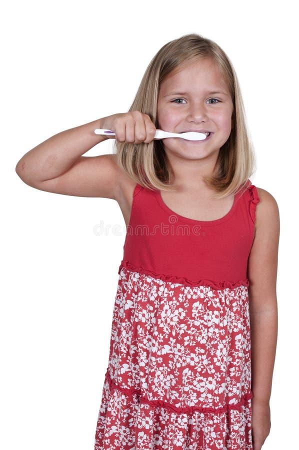 Kleines Mädchen-bürstende Zähne stockfotografie