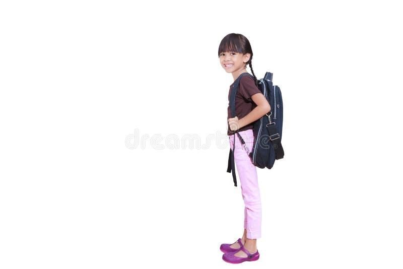 Kleines Mädchen betriebsbereit zur Schule stockbild