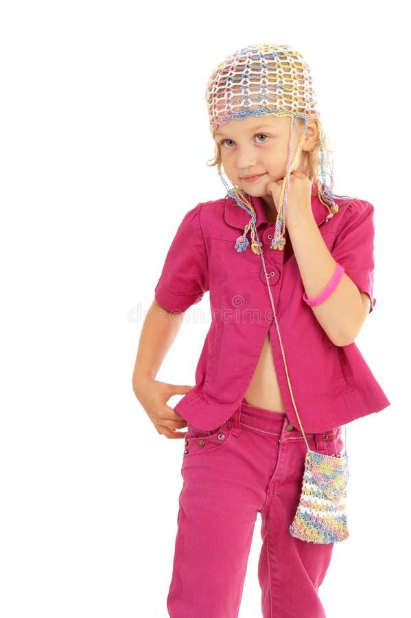 Kleines Mädchen d, das für die Kamera aufwirft lizenzfreies stockfoto