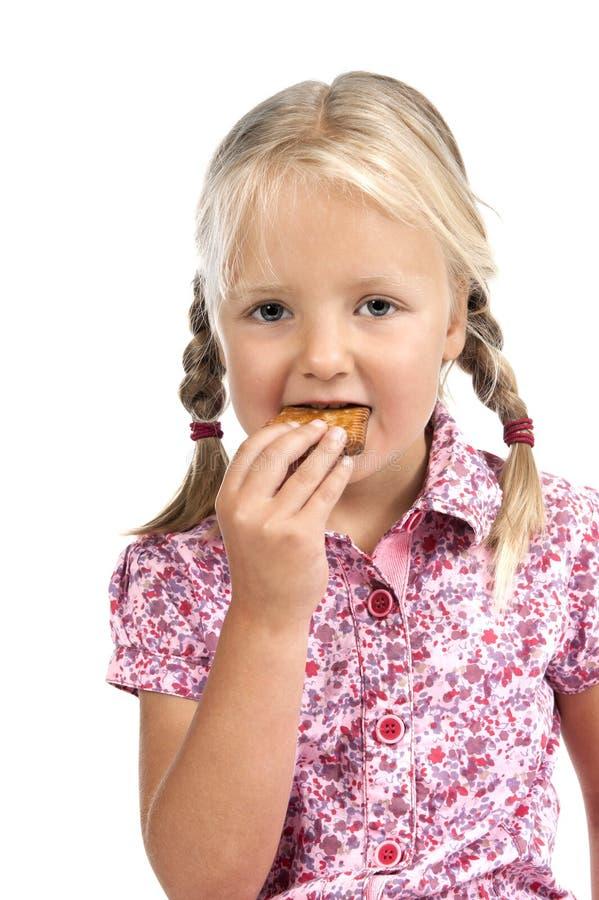 Download Kleines Mädchen, Das Einen Biskuit Isst. Stockbild - Bild von nett, pink: 26372415