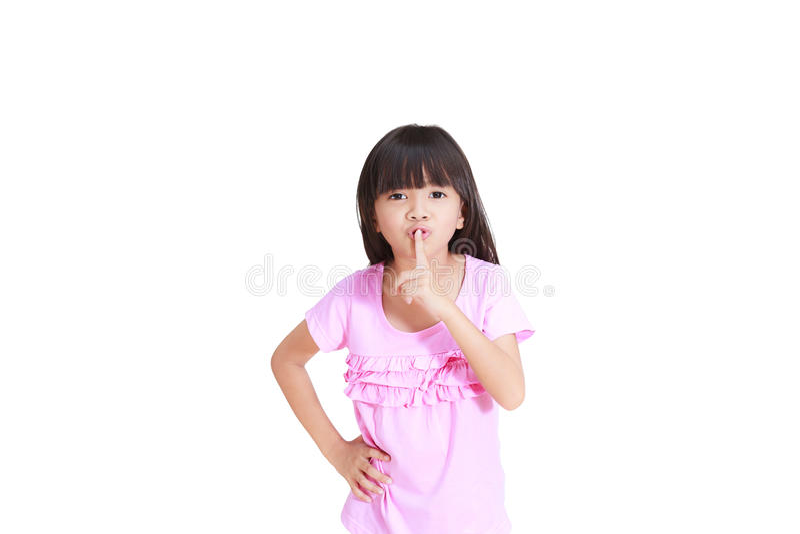 Kleines Mädchen, das für Ruhe gesturning ist lizenzfreie stockbilder