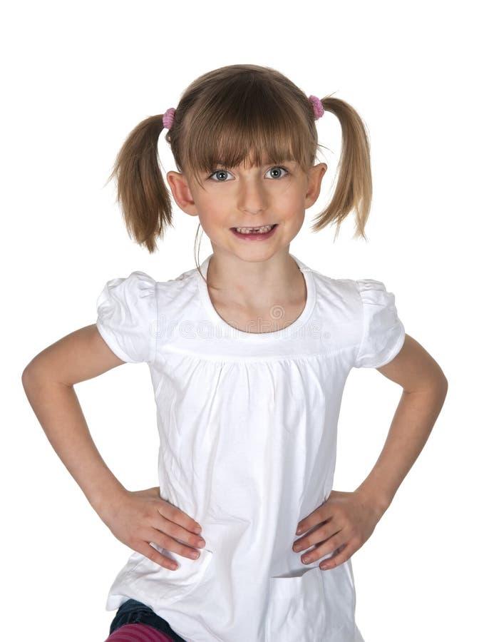 Kleines Mädchen, das ihre Zahnlücke zeigt stockbilder