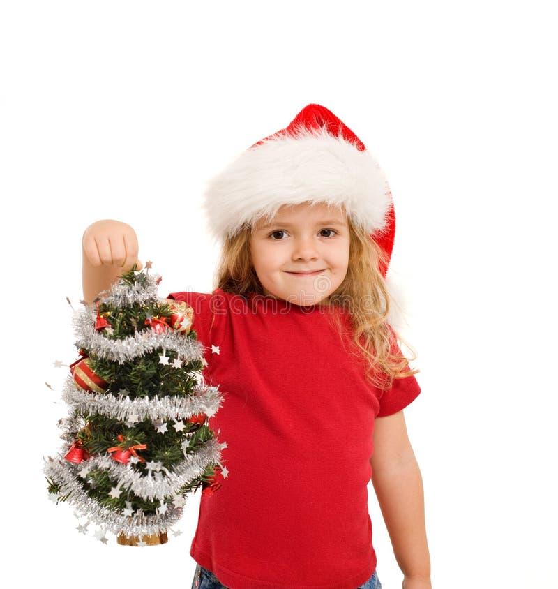 Kleines Mädchen, das kleinen Weihnachtsbaum anhält stockbilder