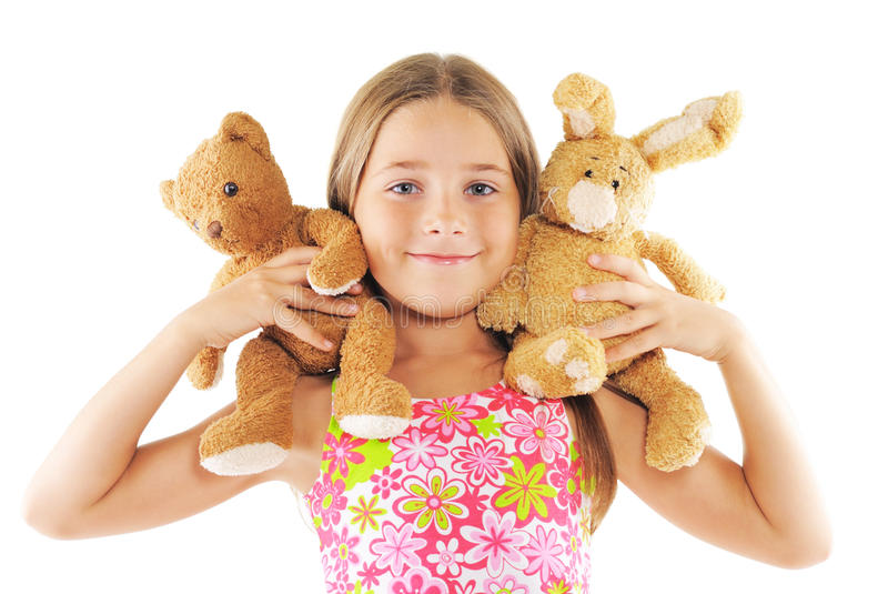Kleines Mädchen, das mit Spielwaren spielt stockbild
