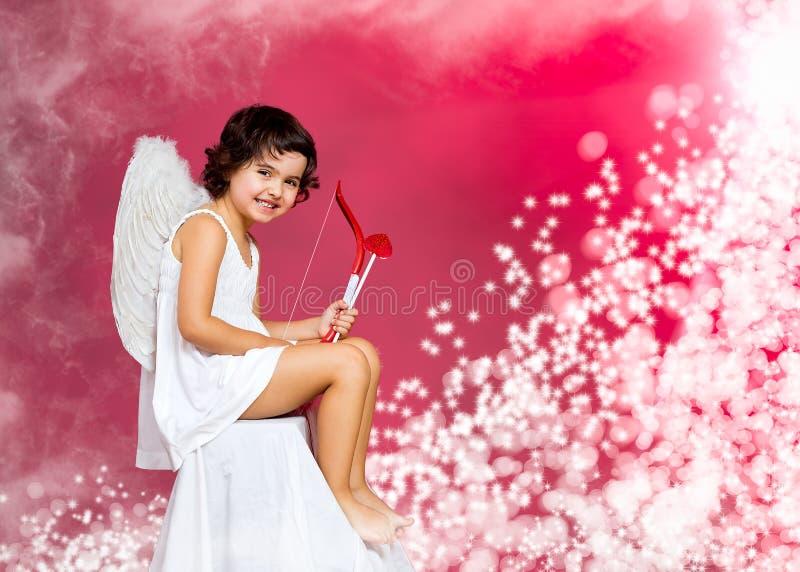 Kleines Mädchen des Amors stockfoto