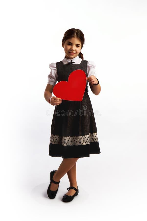 Kleines Mädchen-großes Herz lizenzfreies stockbild