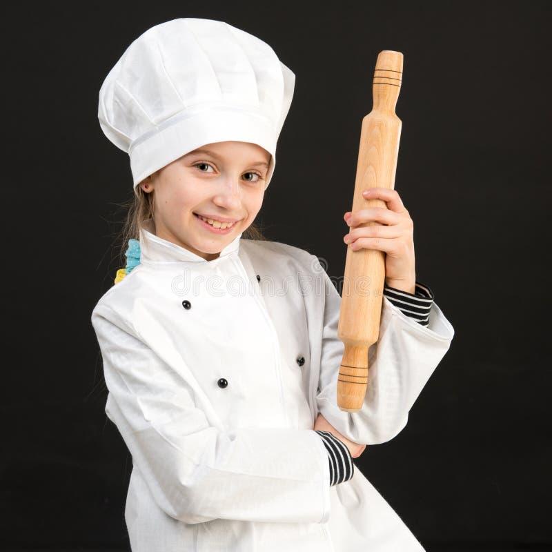 Kleines Mädchen im Chefkostüm stockfoto