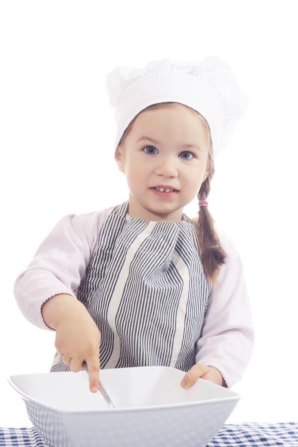 Kleines Mädchen im Kochkostüm stockfoto