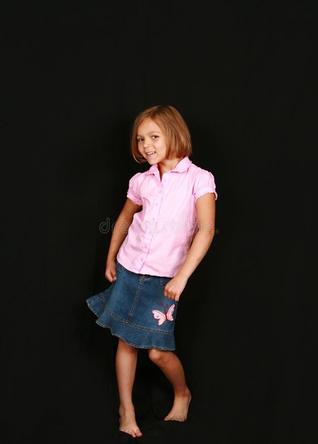 Kleines Mädchen im Rock stockbild