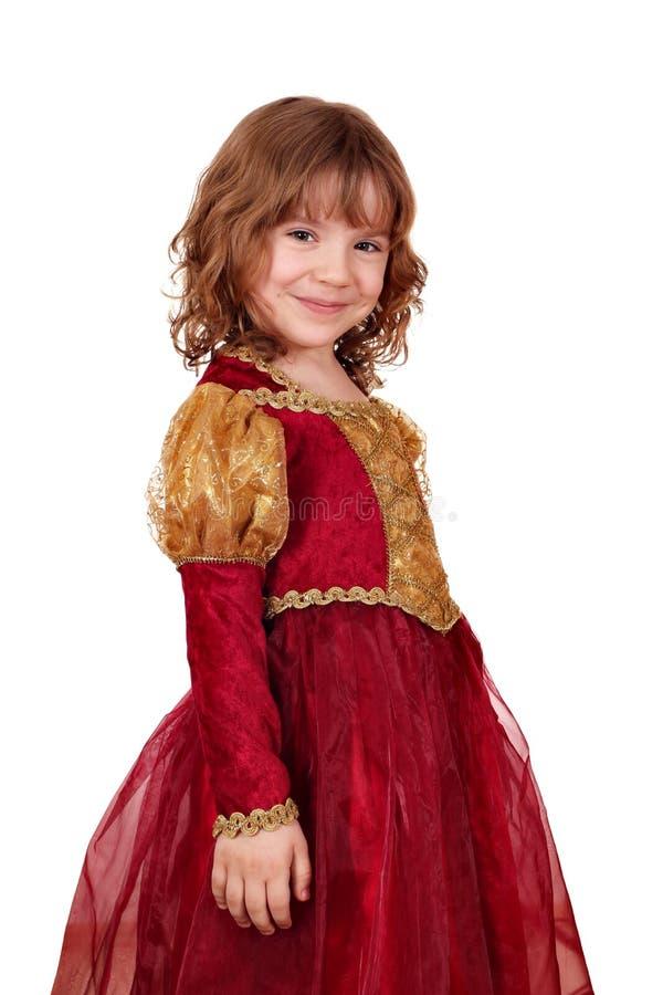 Kleines Mädchen im Rot und im Goldkleid lizenzfreie stockbilder