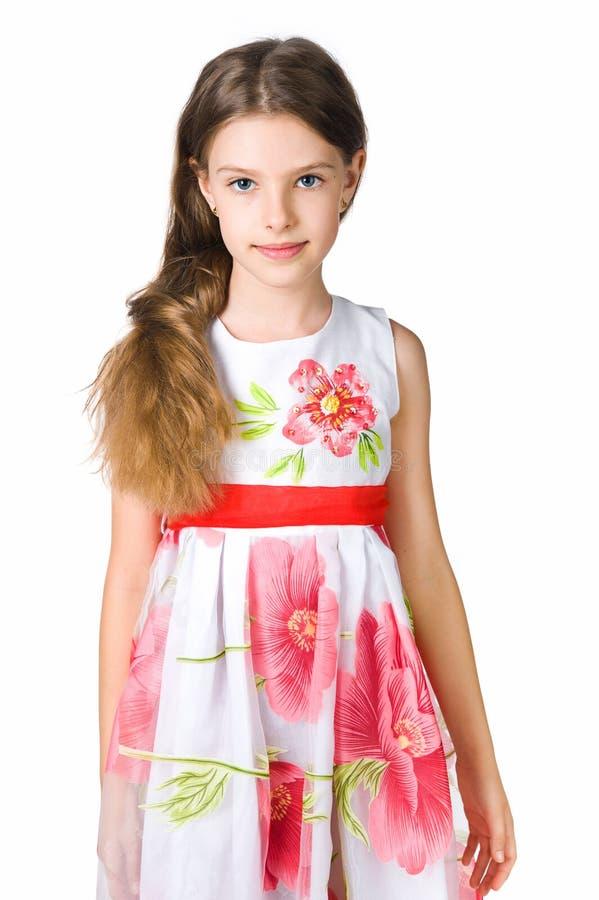 Kleines Mädchen im roten Kleid stockbild