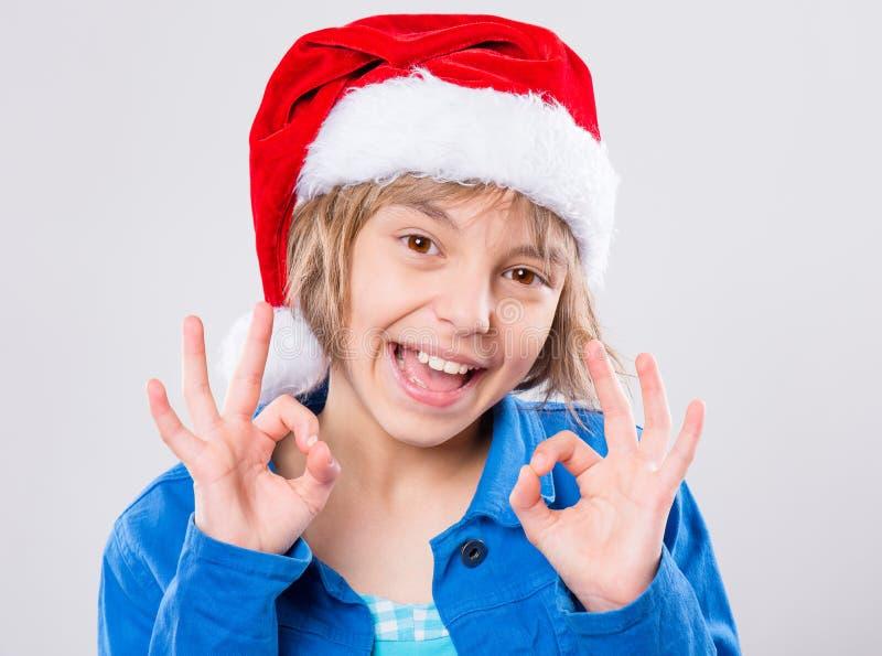 Kleines Mädchen im Sankt-Hut lizenzfreie stockbilder