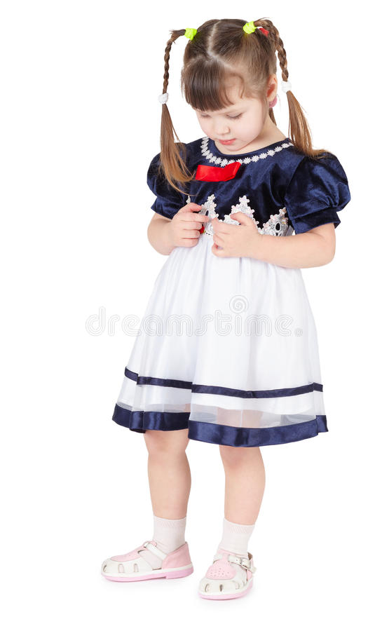 Kleines Mädchen im schönen Kleid schüchtern stockfotos