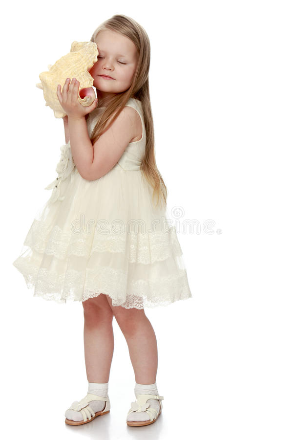 Kleines Mädchen im weißen Kleid stockbild