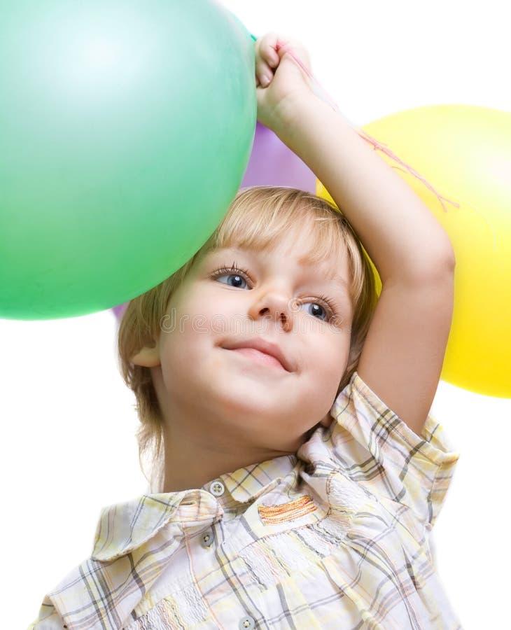 Kleines Mädchen mit Ballonen lizenzfreies stockbild