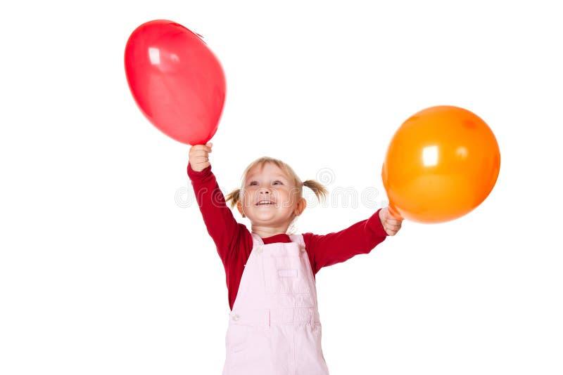 Kleines Mädchen mit Ballons lizenzfreies stockbild