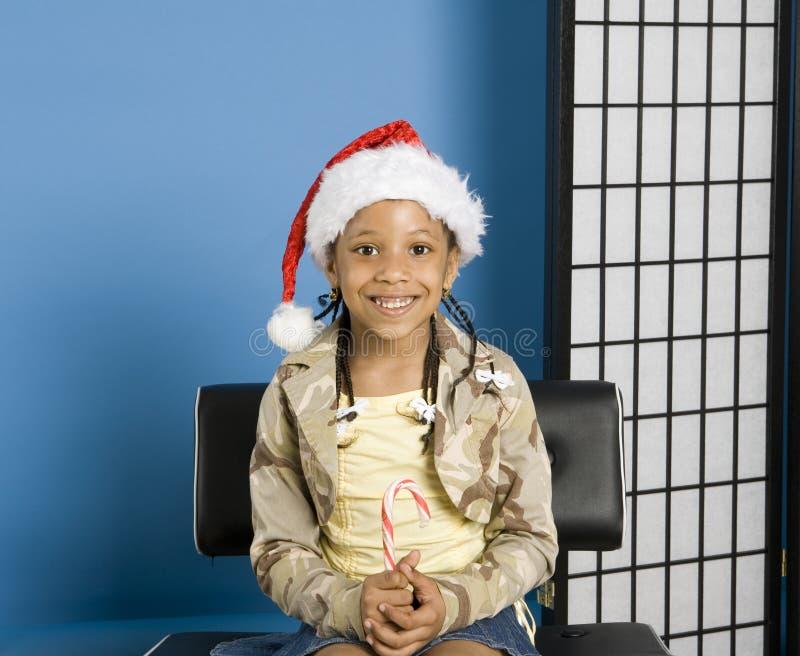 Kleines Mädchen mit einem Sankt-Hut lizenzfreies stockbild