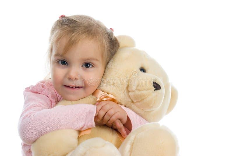 Kleines Mädchen mit einem Teddybären lizenzfreies stockbild