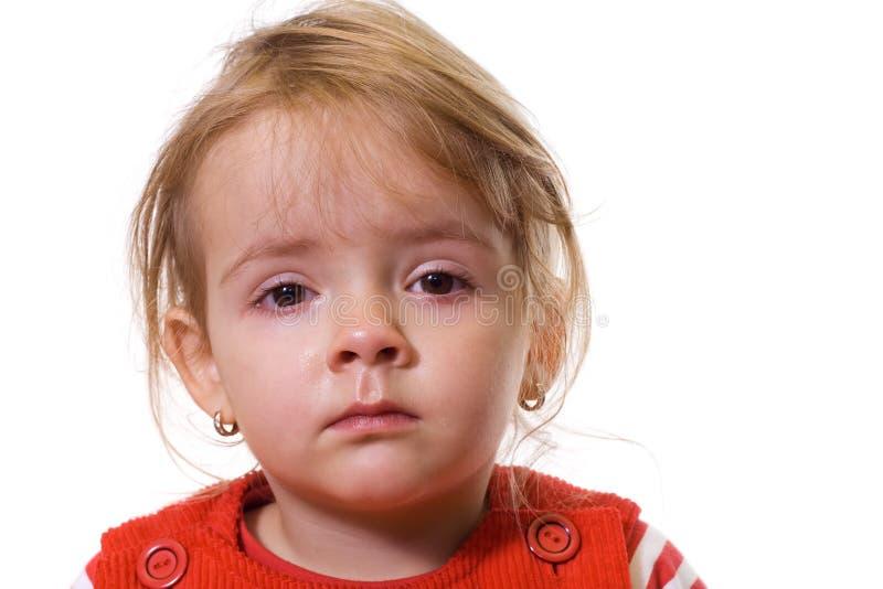 Kleines Mädchen mit einer strengen Grippe lizenzfreies stockfoto