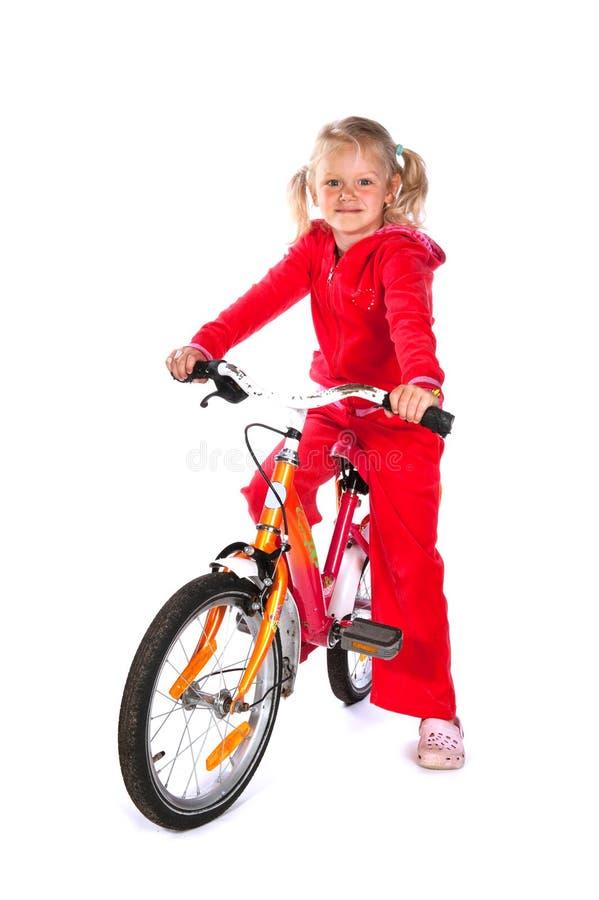 Kleines Mädchen mit Fahrrad stockbilder