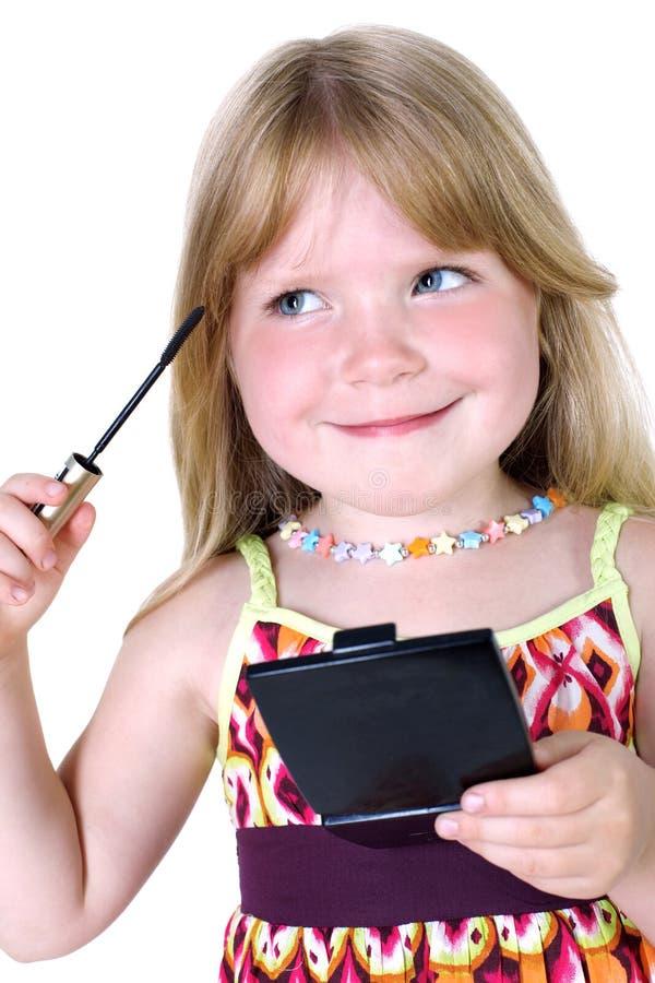 Kleines Mädchen mit flüssiger Wimperntusche lizenzfreie stockfotos