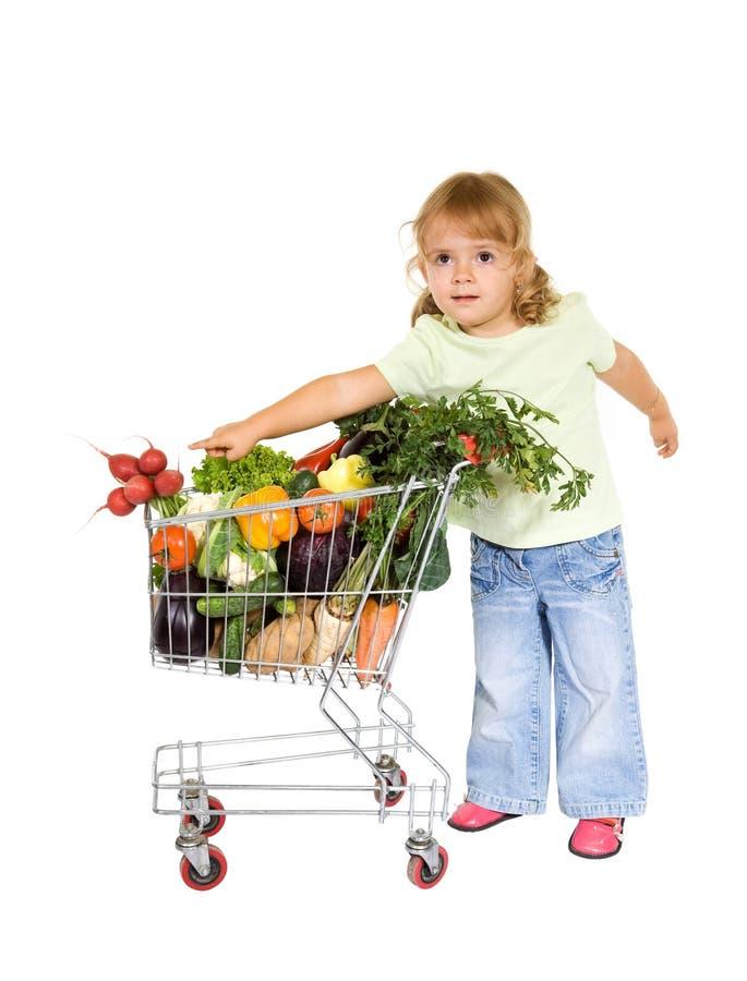 Kleines Mädchen mit gesunder Nahrung stockbilder