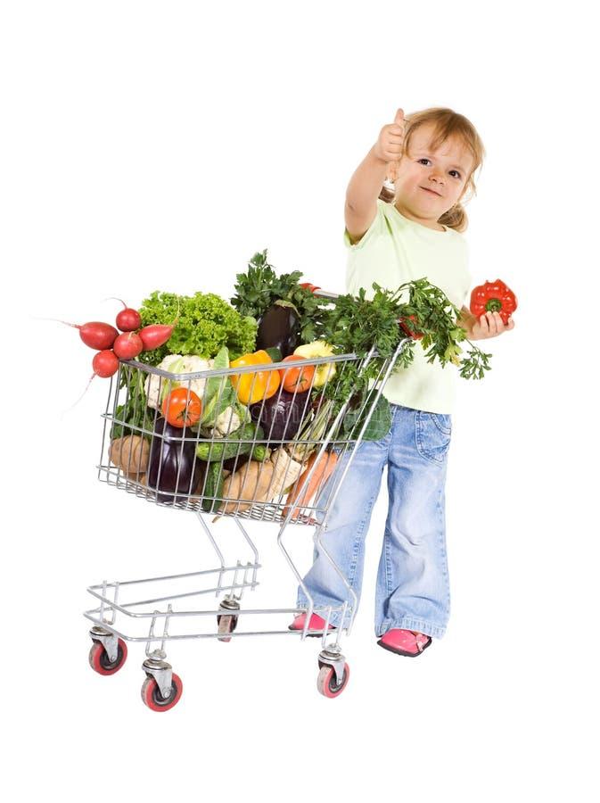 Kleines Mädchen mit gesunder Nahrung lizenzfreie stockfotos
