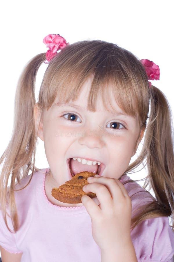Kleines Mädchen mit Hafermehlplätzchen lizenzfreies stockfoto
