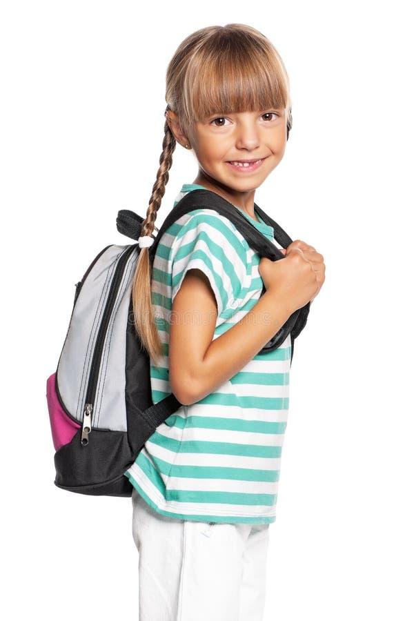 Kleines Mädchen mit Rucksack lizenzfreie stockbilder