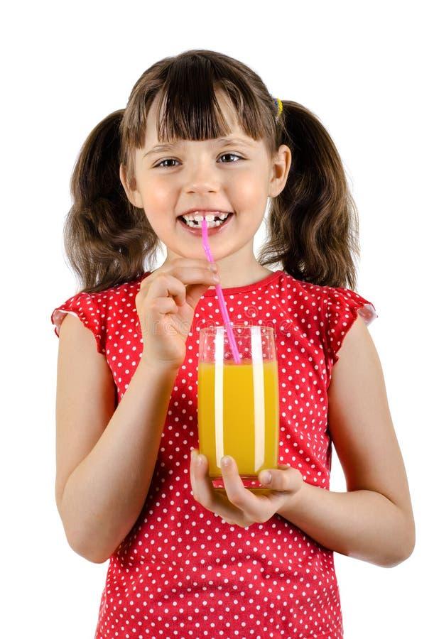 Kleines Mädchen mit Saft stockfotos