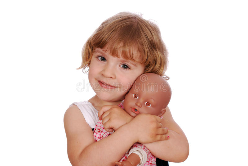Kleines Mädchen mit Schätzchen - Puppespielzeug lizenzfreies stockfoto