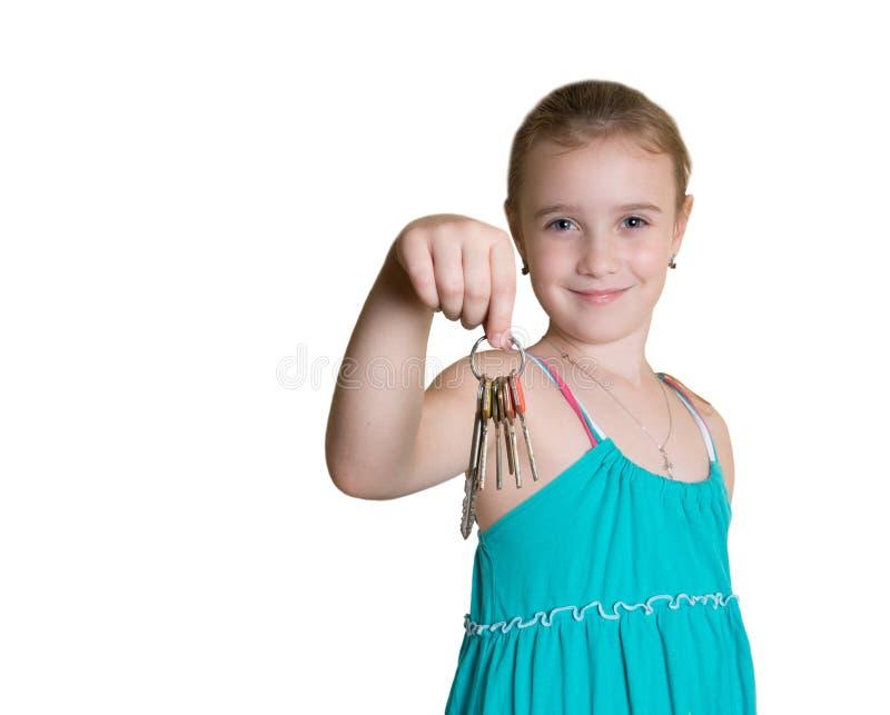 Kleines Mädchen mit Schlüsseln stockfotos