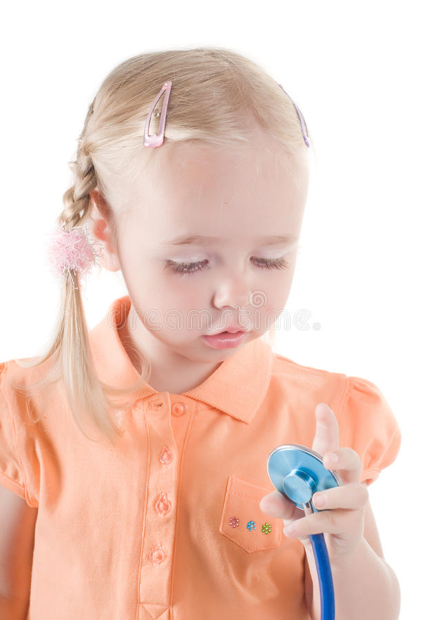 Kleines Mädchen mit sthetoscope stockfotos
