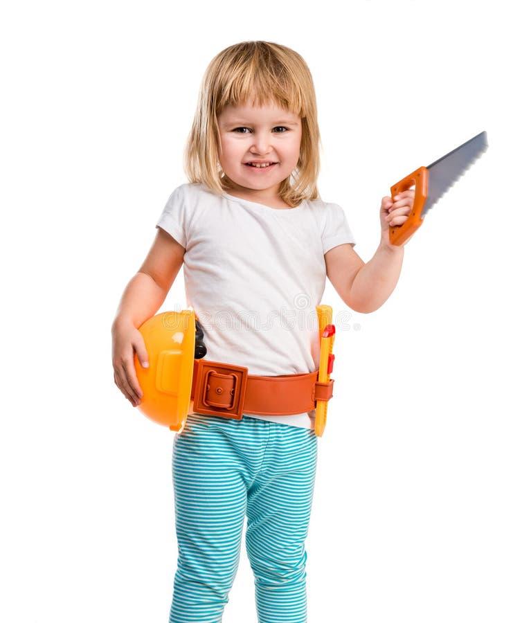 Kleines Mädchen mit Sturzhelm und Instrumenten lizenzfreies stockbild