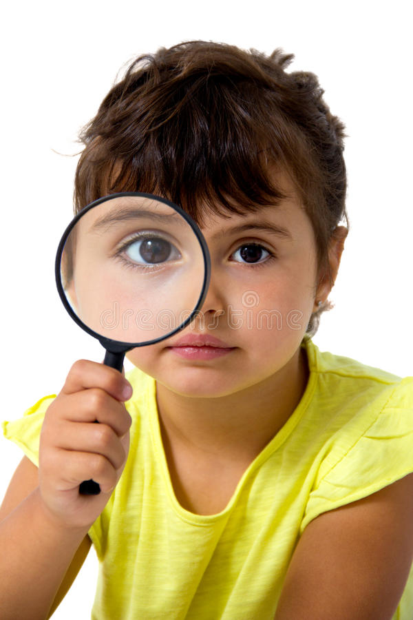 Kleines Mädchen mit Vergrößerungsglas lizenzfreies stockbild