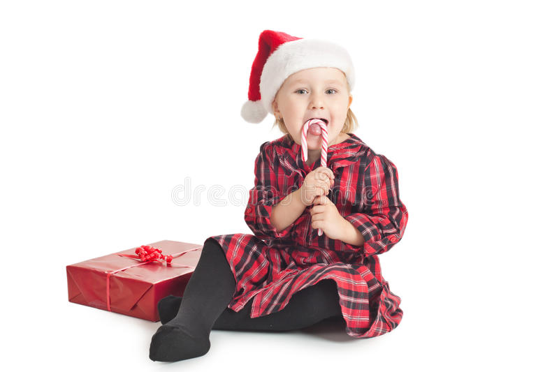 Kleines Mädchen mit Weihnachtsgeschenk lizenzfreies stockfoto