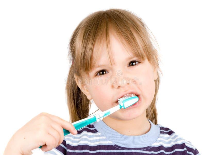 Kleines Mädchen mit Zahnbürste stockfoto