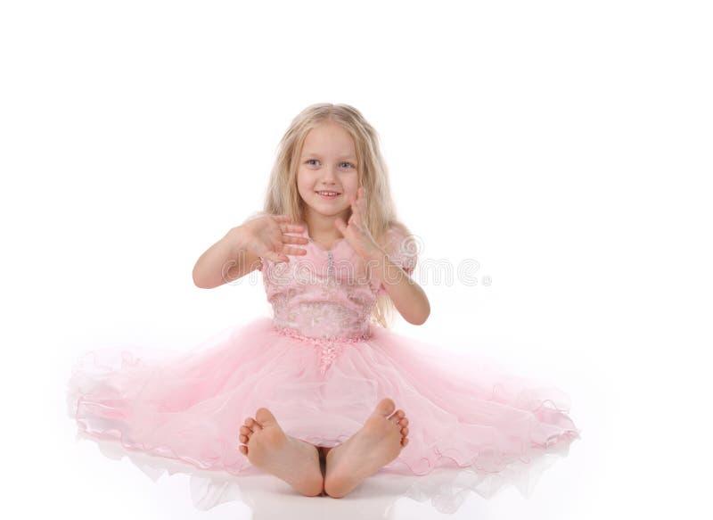 Kleines Mädchen in rosafarbene dres stockbild